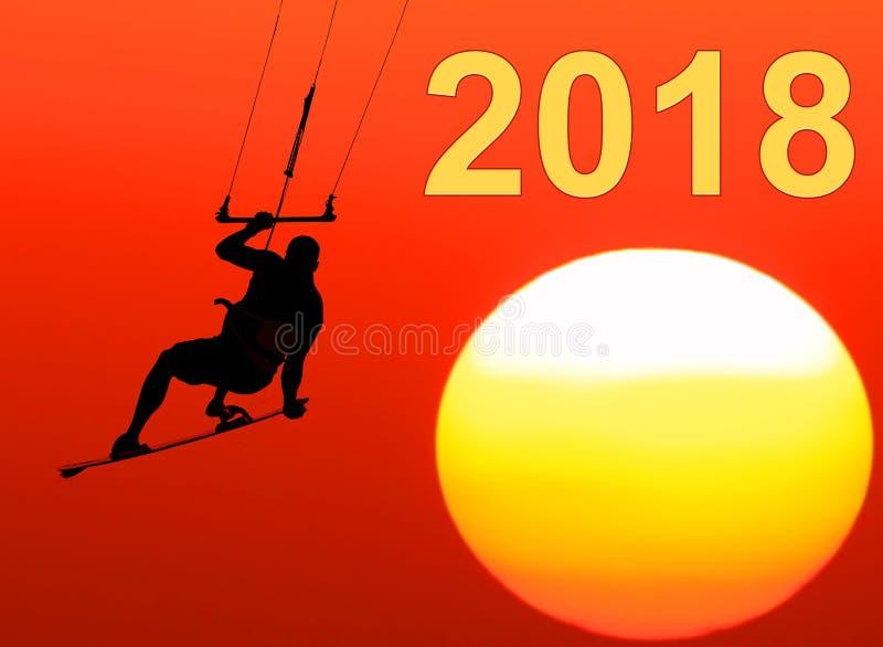 2018个新年 风筝在日落的冲浪者飞行 库存图片