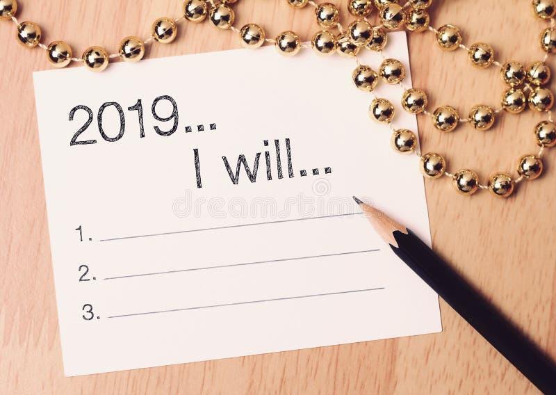 2019个目标列出与金装饰 我们祝愿您一个新年充满奇迹、和平和意思 免版税库存照片