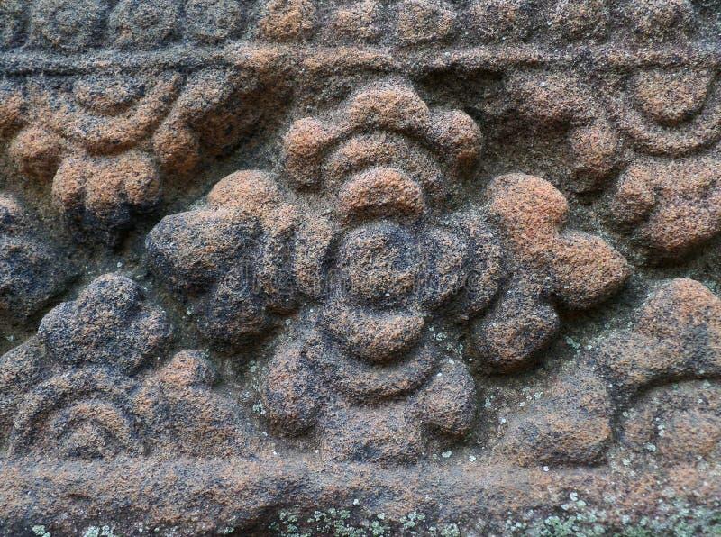中世纪被雕刻的石墙的独特的花纹花样在Prasat Hin Muang Tam,高棉寺庙在泰国 库存照片
