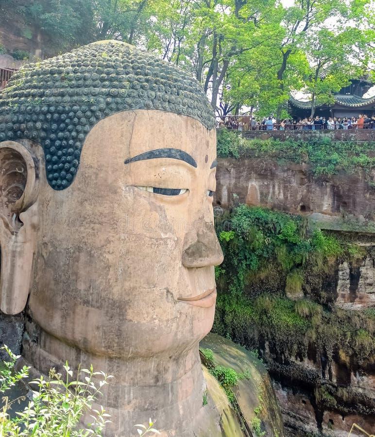 中国乐山巨人菩萨,巨大的菩萨雕象,文化风景 峨眉山风景区,包括乐山风景盛大的菩萨是 库存照片