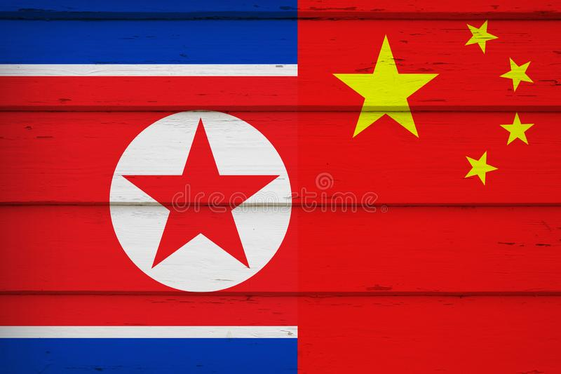 中国和北朝鲜的旗子 免版税库存图片