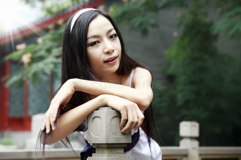 中国女孩头发长室外 免版税库存照片