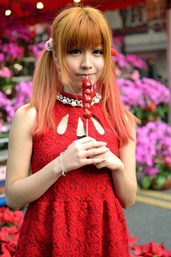 中国女孩庆祝农历新年 免版税库存图片