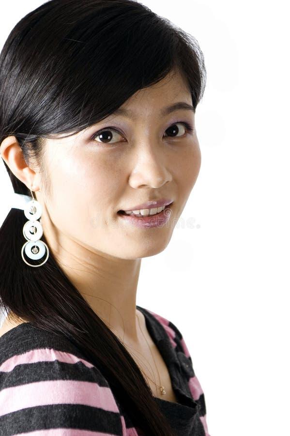 中国女孩纵向微笑 免版税库存图片