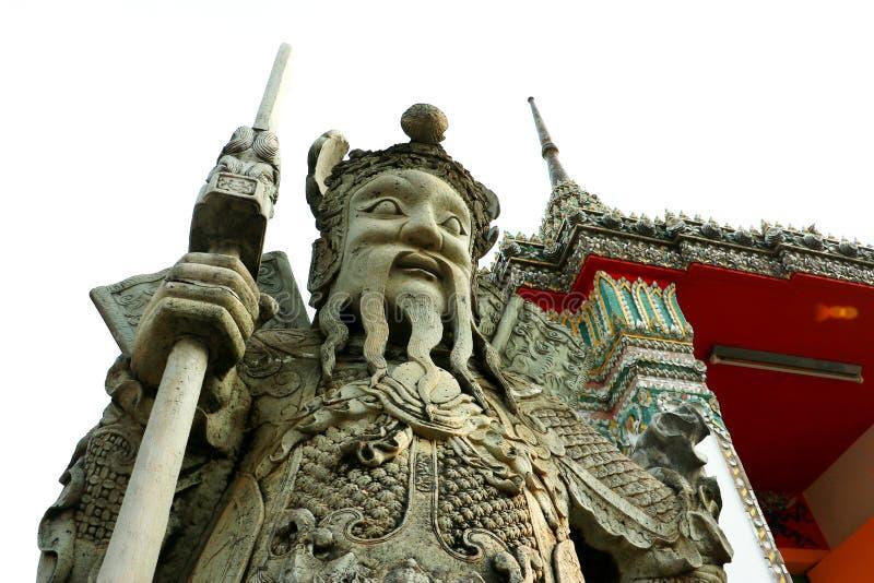 中国石雕塑,古老中国石玩偶室外装饰,中国战士雕塑的雕象在Wat Pho,曼谷 免版税库存照片