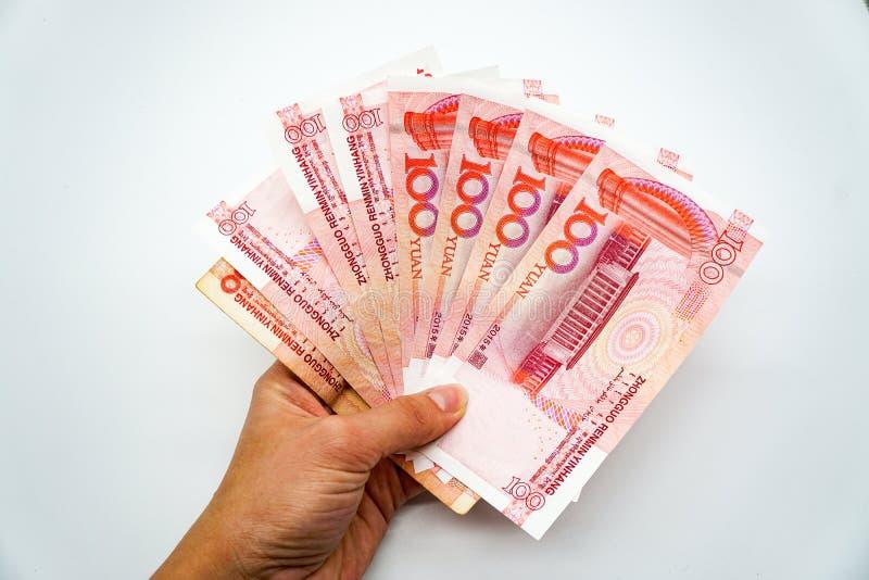中国货币,金钱,元,金钱爱好者在手中在白色背景,孤立 库存照片