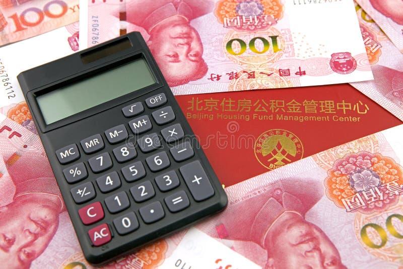 中国金钱和计算器有住房储积的资助存折 库存图片