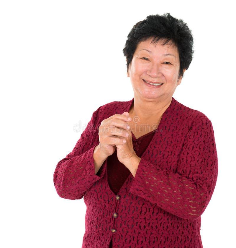 中国高级妇女问候 免版税库存图片