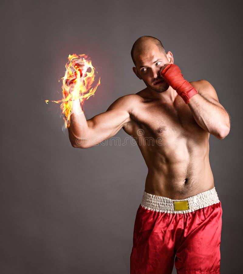 击中拳击手的火 库存图片