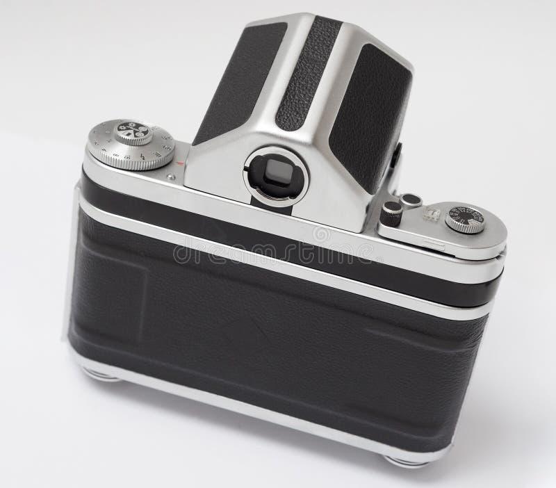 中等格式老减速火箭的古色古香的影片模式照相机后面 免版税库存照片