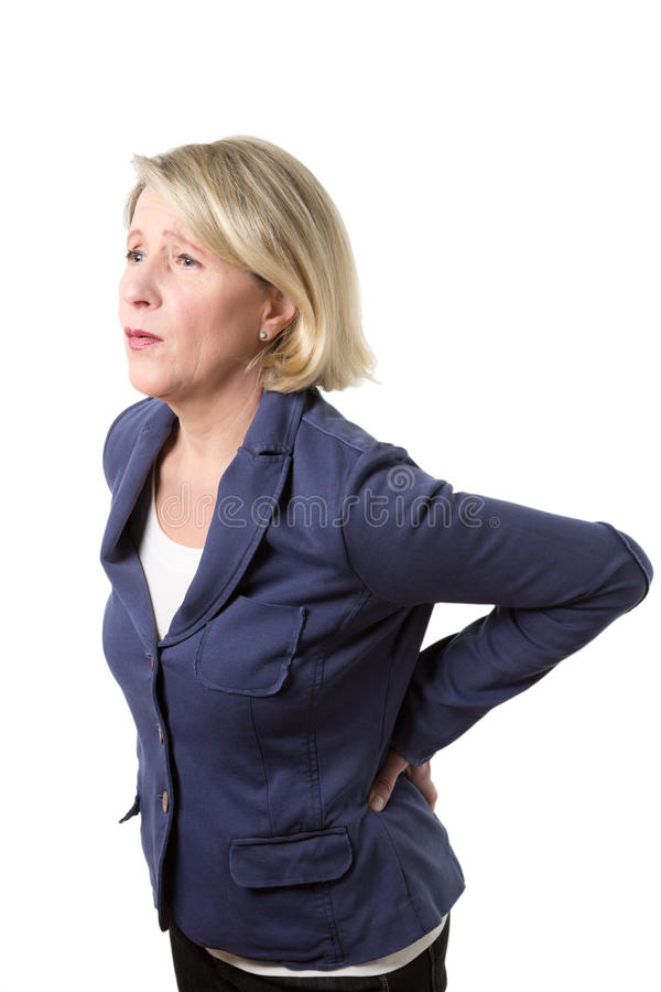 中部年迈的妇女以腰痛 免版税库存图片
