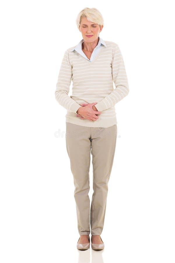 中间年龄妇女肚子疼 免版税库存照片