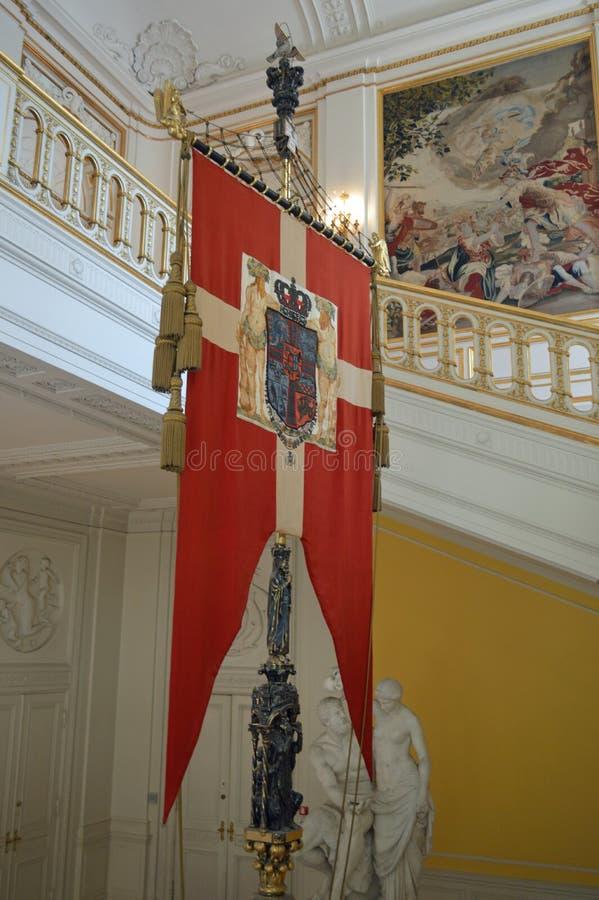 丹麦旗子-女王挂毯- Christainsborg宫殿哥本哈根内部  库存图片