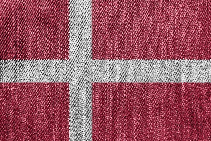 丹麦纺织工业或政治概念:丹麦旗子牛仔布牛仔裤 库存图片