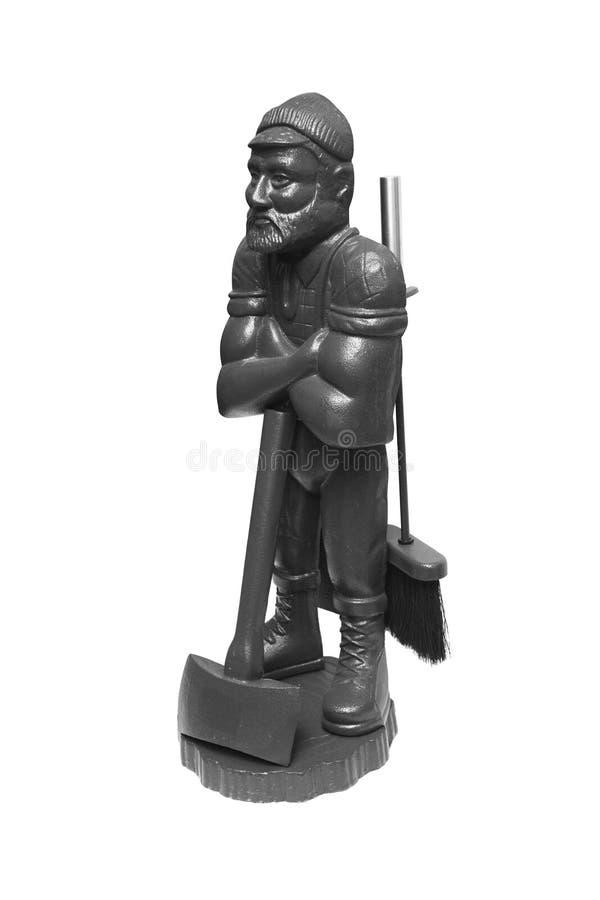 为壁炉设置 装饰小雕象axeman 库存照片