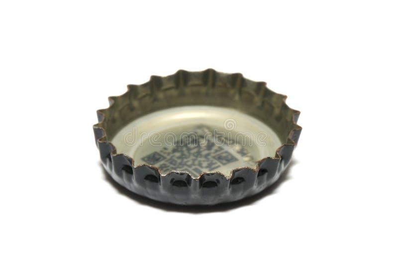 为密封被装瓶的流体在过去使用的一个被打开的瓶盖 库存图片