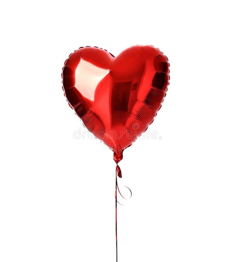 为生日选拔大红色心脏气球对象被隔绝的 库存图片
