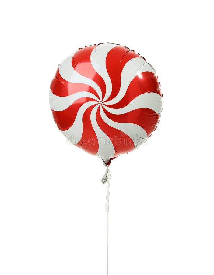 为生日选拔红色大圆的糖果lollypop气球对象被隔绝的 库存图片