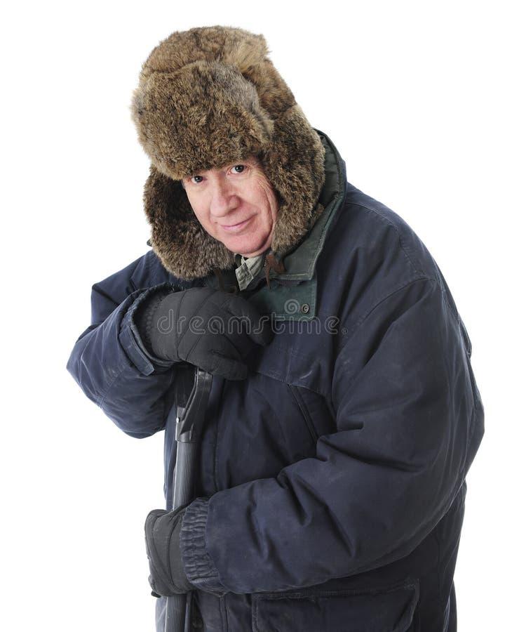 为雪包的前辈Snoveling 免版税库存照片