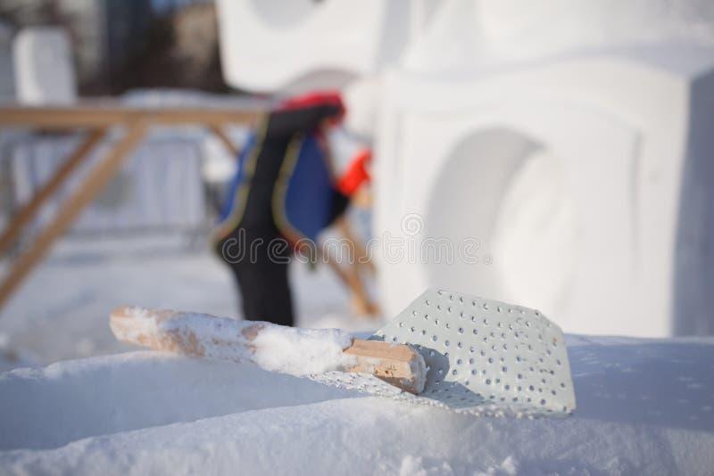 为雪雕的建筑的工具 库存照片