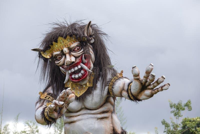 为Ngrupuk游行塑造的Ogoh-ogoh雕象,在甚而发生Nyepi天在巴厘岛,印度尼西亚 库存照片