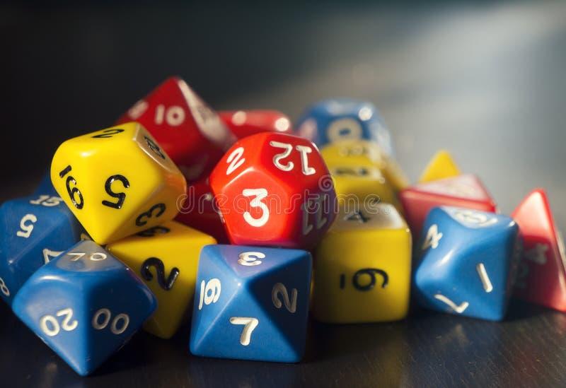 为rpg、棋或者桌面比赛切成小方块在黑暗的背景 免版税图库摄影