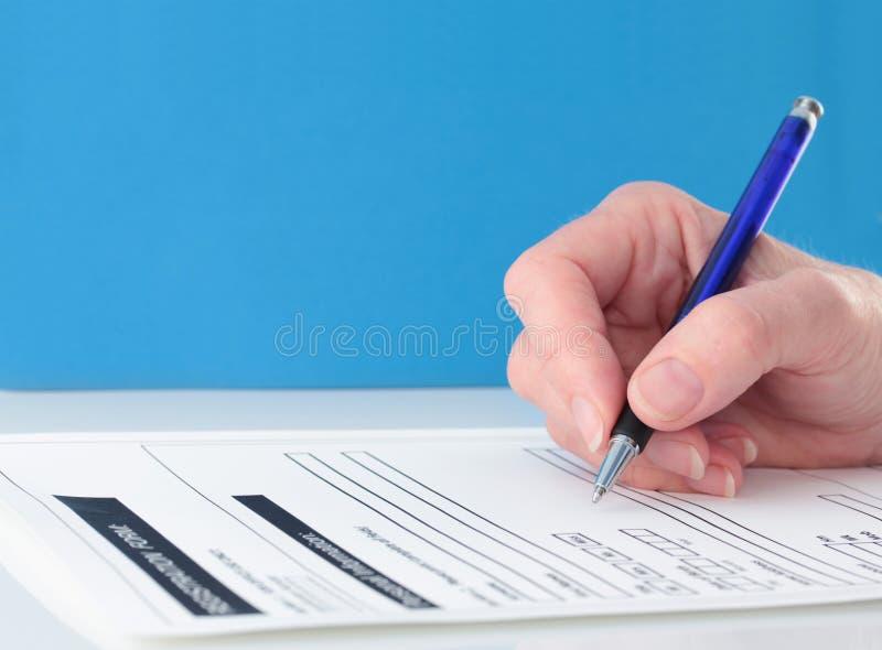 主题蓝色完成的表单现有量的笔 免版税库存图片