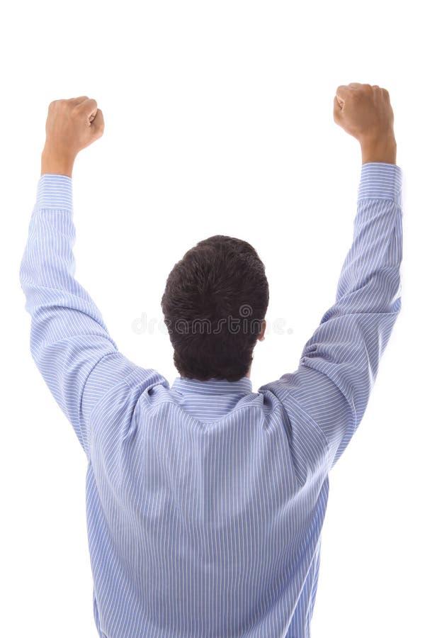 举他的手的愉快的商人  库存照片