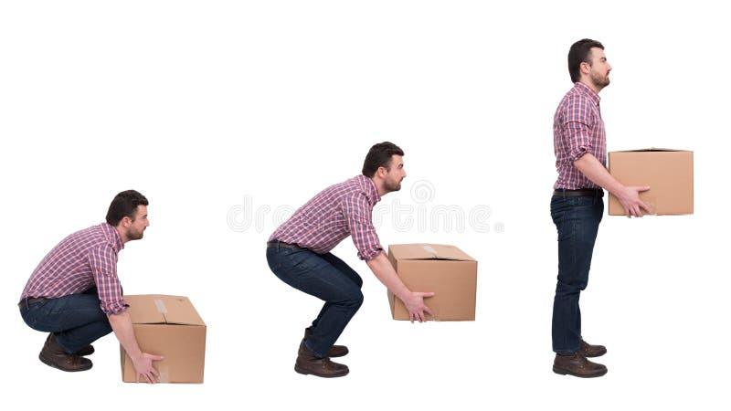 举反对腰疼的适当的重量级的箱子 免版税库存照片