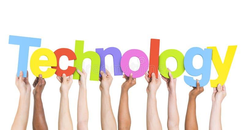 举行五颜六色的词技术的手 库存照片