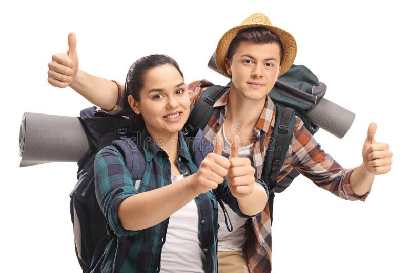 举行他们的赞许的少年游人 免版税库存照片