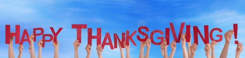 举行在天空的许多人民愉快的感恩 免版税库存图片