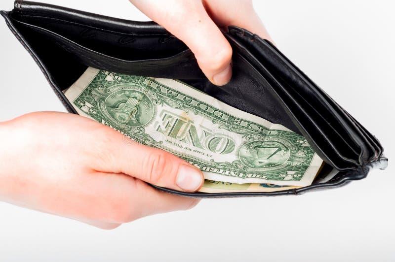 举行在手上打开有金钱的钱包在它 免版税库存照片