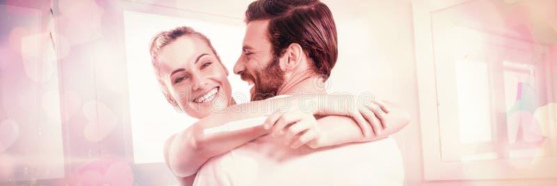 举行妊娠试验的妇女,当拥抱人时 库存图片