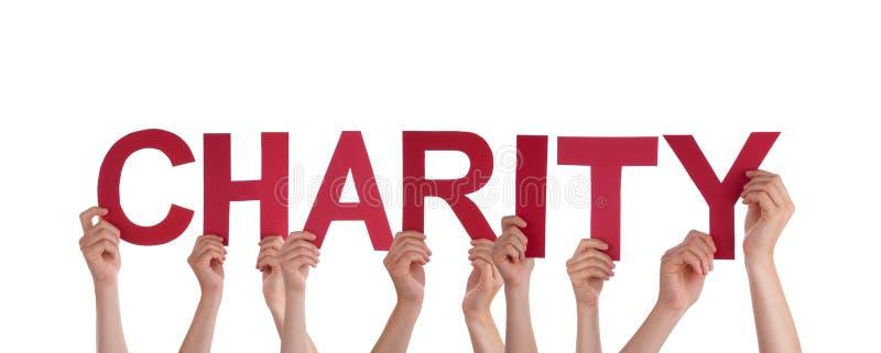 举行慈善的人们 免版税库存图片