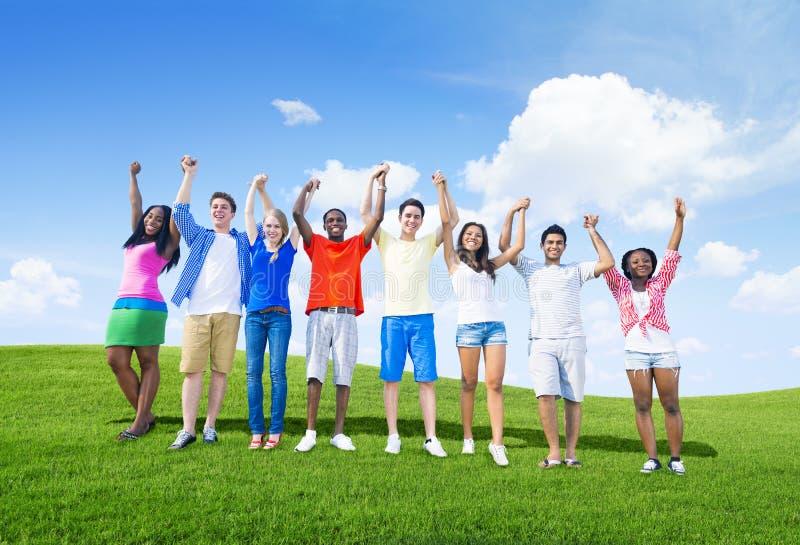 举行手和庆祝的小组少年 库存照片