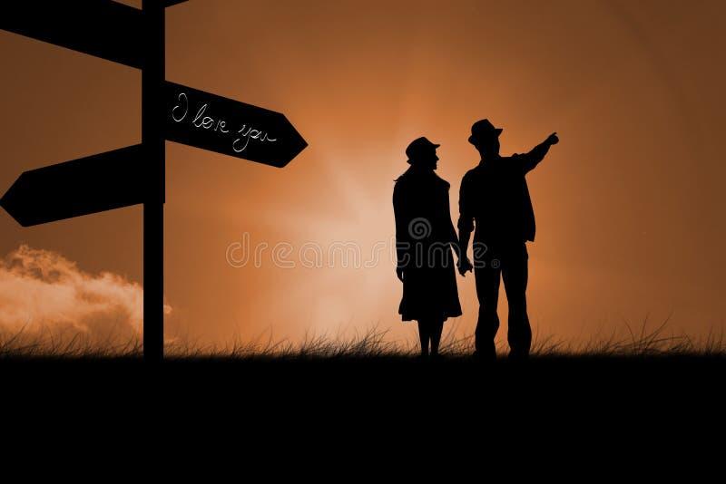 举行手和看的愉快的行家夫妇的综合图象 免版税库存照片