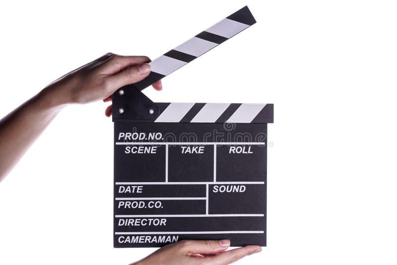 举行拍板或板岩影片概念的手 库存图片