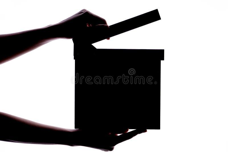 举行拍板或板岩影片概念的手 免版税图库摄影