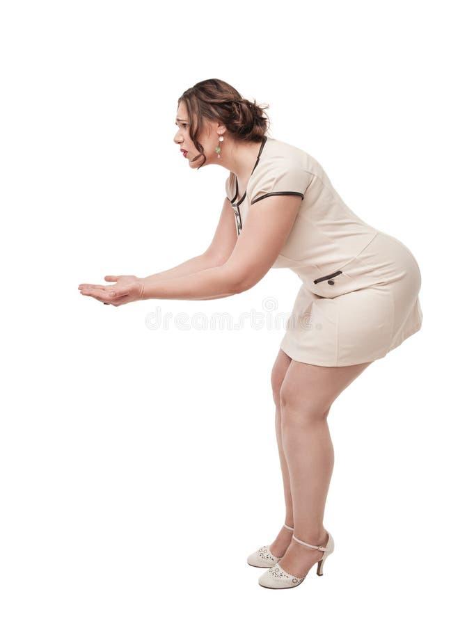 举行某事在她的手上的正大小妇女 免版税库存照片