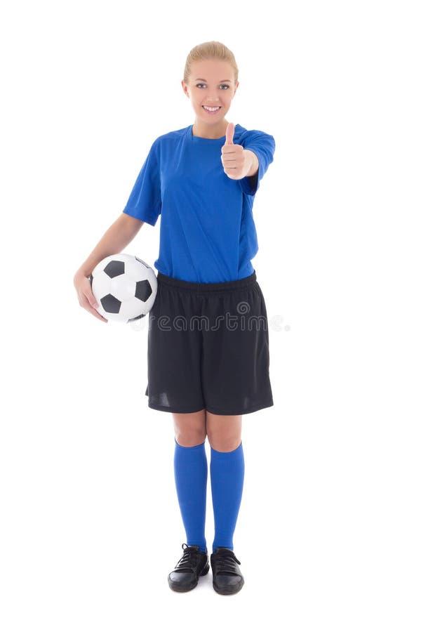 举行球赞许的蓝色制服的女性足球运动员 免版税库存照片