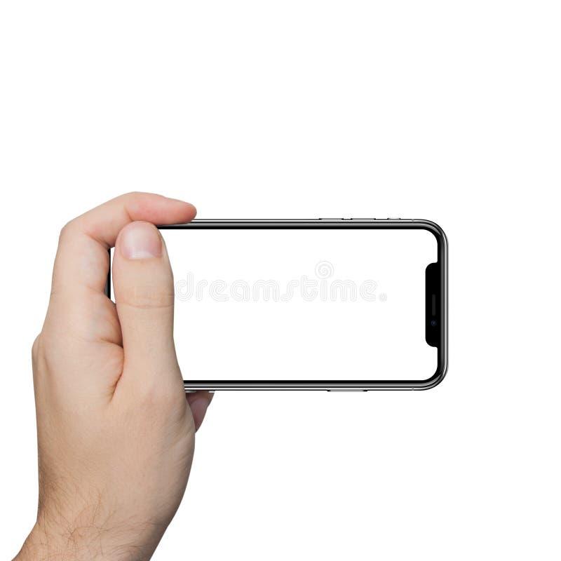 举行电话片剂接触的被隔绝的男性手 图库摄影