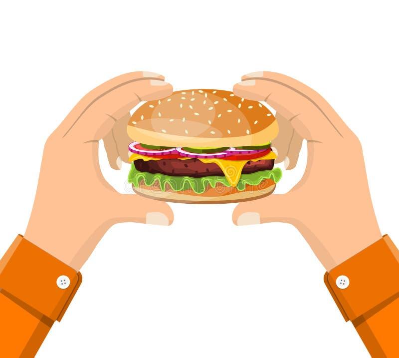 举行的汉堡包在手中,吃快餐概念 皇族释放例证