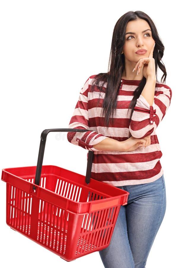举行空的购物的少妇 免版税库存照片