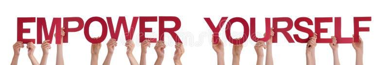 举行红色平直的词的手授权自己 库存图片