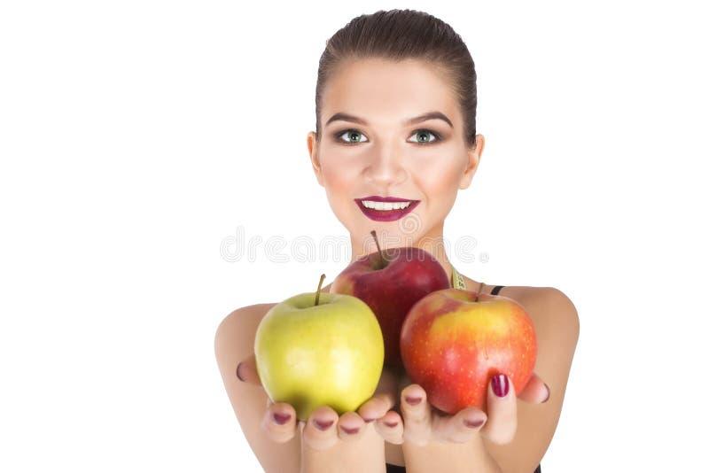 举行苹果饮食概念的妇女 库存照片