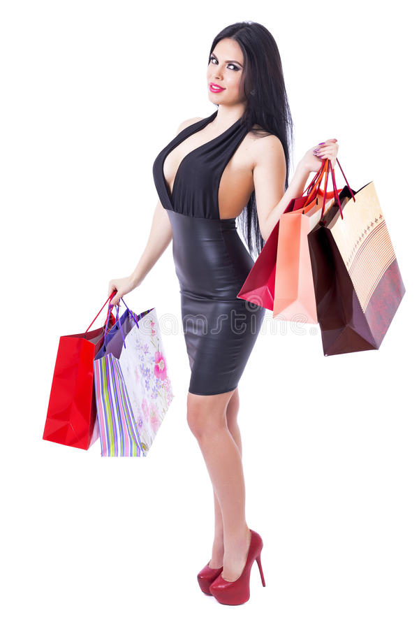 举行购物的时髦的美丽的妇女全长画象  库存照片