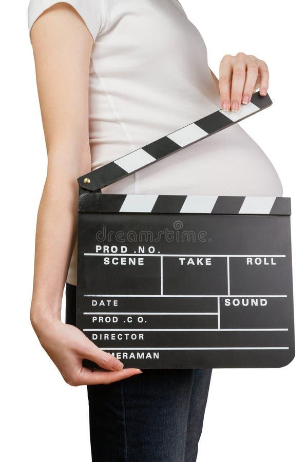举行clapperboard的孕妇 免版税图库摄影