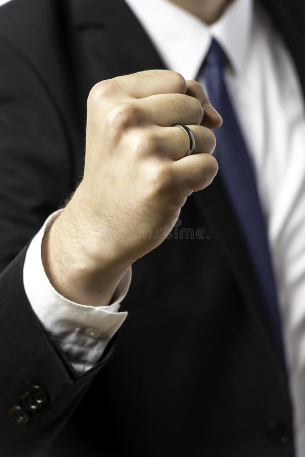 举起他的拳头的商人 库存图片