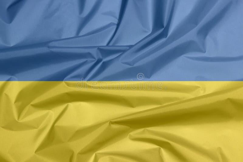 乌克兰的织品旗子 乌克兰旗子背景折痕  库存图片